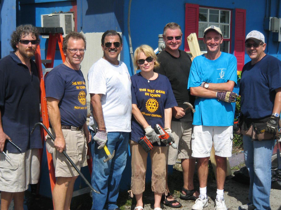 A well-armed group of Rotarians on a construction build site.