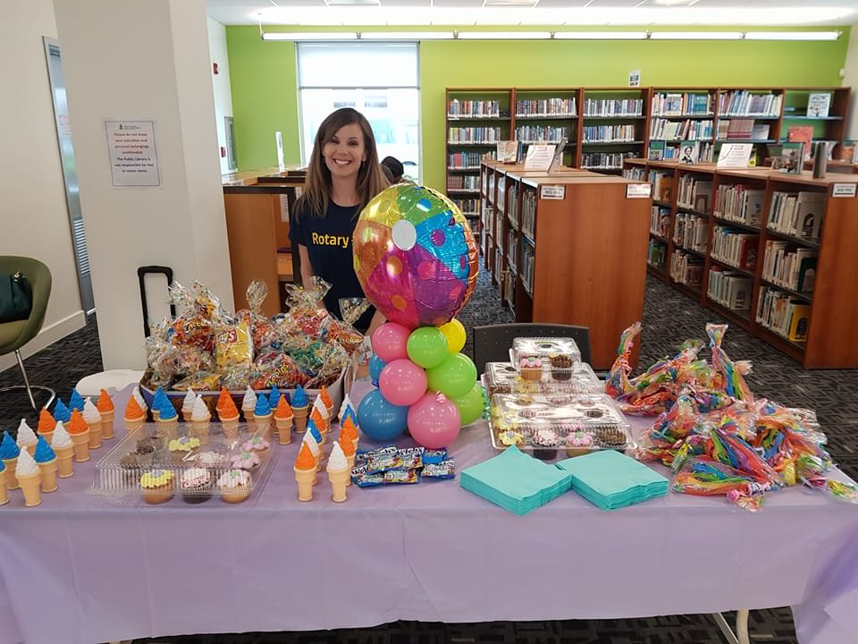 Rotarian Katherin Dilbert, former Director of Vocational Service, at the  Reading Program at the Public Library's for Children in all Districts - with refreshments.